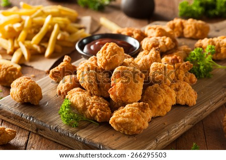 Homemade Crispy Popcorn Chicken with Barbecue Sauce - stock photo
