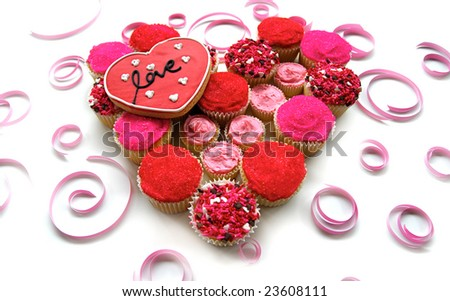 Homemade cupcakes in a heart shape with love cookie - stock photo