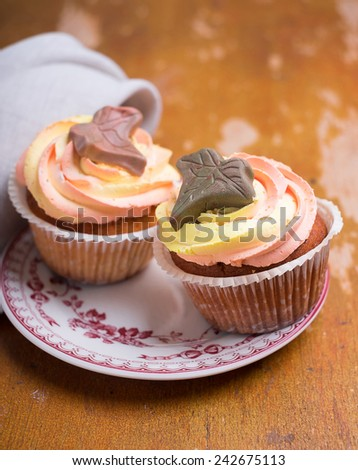 Homemade cupcakes with buttercream on a dessert plate for Valentines day, Mother's day or Easter holiday - stock photo