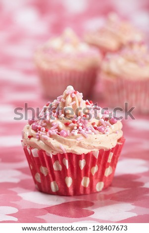homemade Cupcakes with heart decoration - stock photo