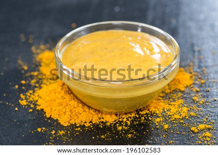 Homemade Curry Sauce in a small bowl (close-up shot) - stock photo