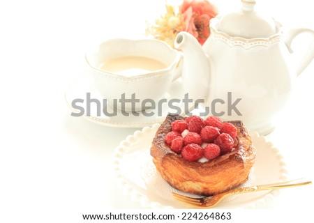 Homemade Danish pastry, raspberry and yogurt on pie - stock photo