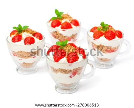 homemade desert with cream chopped cookies and fresh strawberry on white - stock photo