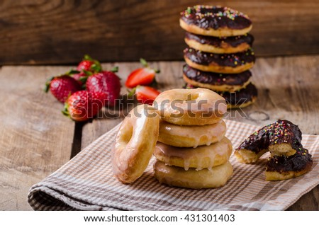 Homemade donuts with sugar and chocolate, rustic dipped - stock photo