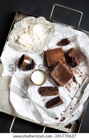 Homemade Double Chocolate Cake, Meringues and Milk. Moody Atmosphere - stock photo