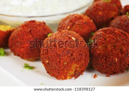 Homemade falafel served with Tzatziki. - stock photo