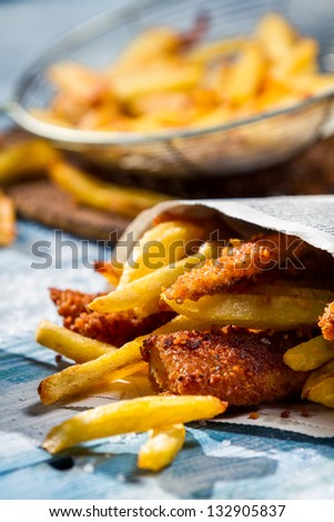 Homemade Fish & Chips served in the newspaper - stock photo