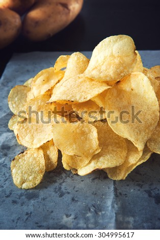 homemade flavored potato chips pile  - stock photo