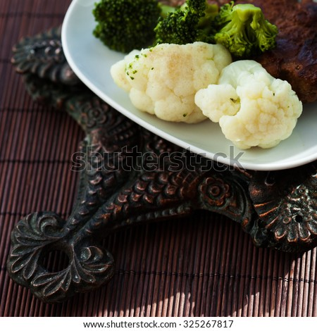 homemade food. Meat steamed with cauliflower and broccoli, top view - stock photo