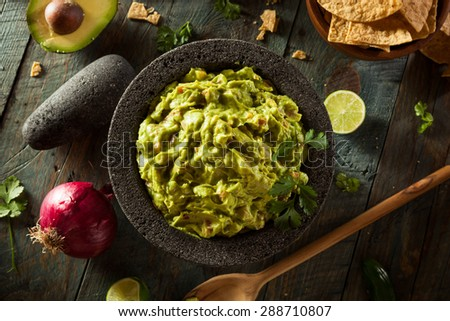 Homemade Fresh Guacamole and Chips Ready to Eat - stock photo