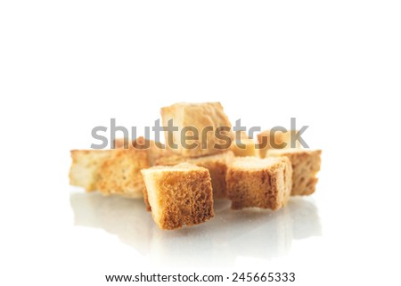 homemade fried bread croutons on a white background - stock photo