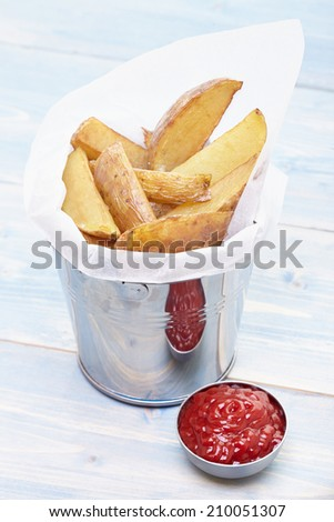 Homemade Fries in a small metal bucket with and ketchup - stock photo