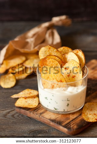 Homemade fries potato ships with dip served in glass. - stock photo
