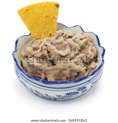 homemade frijoles with tortilla chips, totopos, mexican snack - stock photo