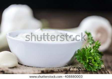 Homemade Garlic Sauce (detailed close-up shot) on wooden background - stock photo