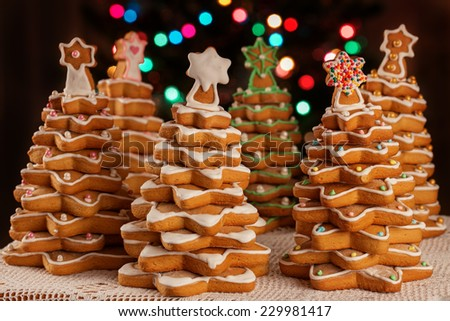 Homemade Gingerbread cookies  Christmas Trees, decorated with icing and sugar decorations - stock photo