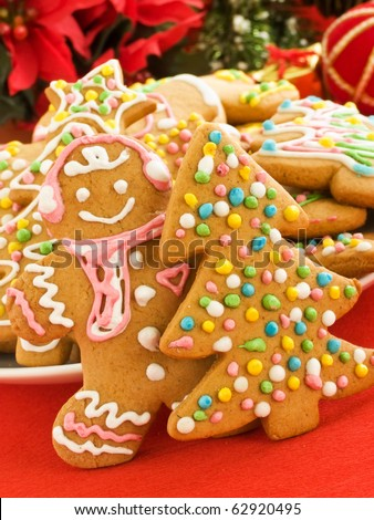 Homemade gingerbread cookies with colored glaze. Shallow dof. - stock photo