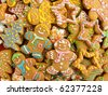 Homemade gingerbread cookies with colored glaze. Viewed from above. - stock photo