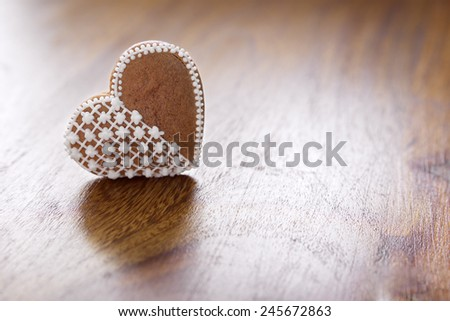 Homemade gingerbread hearts on Wooden table, reflection and shine - stock photo