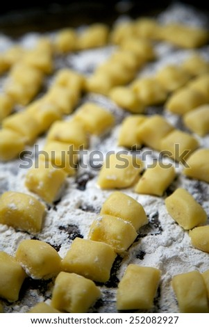 Homemade Gnocchi Pasta with Flour on Cookie Sheet - stock photo