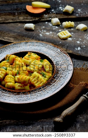 Homemade gnocchi with sweeth potatoes and garlic - stock photo