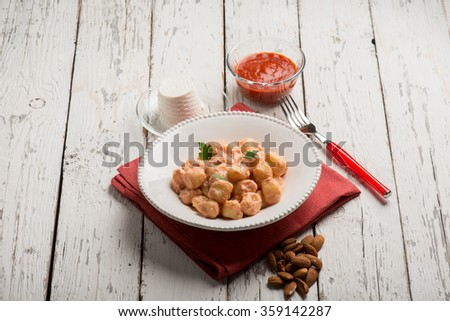 homemade gnocchi with tomato sauce and ricotta - stock photo