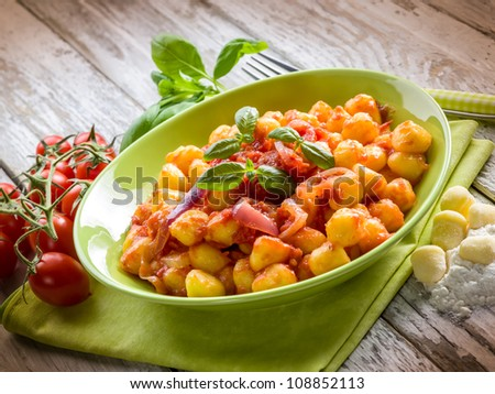 homemade gnocchi with tomato sauce basil and onions - stock photo