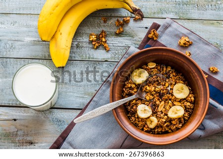 homemade granola with bananas, nuts and dates, milk, healthy food - stock photo