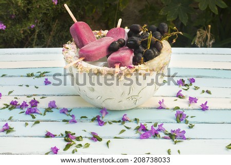 homemade grapes Popsicles in an  ice bowl - stock photo