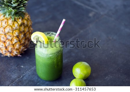 Homemade green detox juice, with pineapple and lime - stock photo