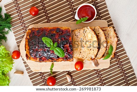 Homemade ground meatloaf with ketchup and basil. Top view - stock photo