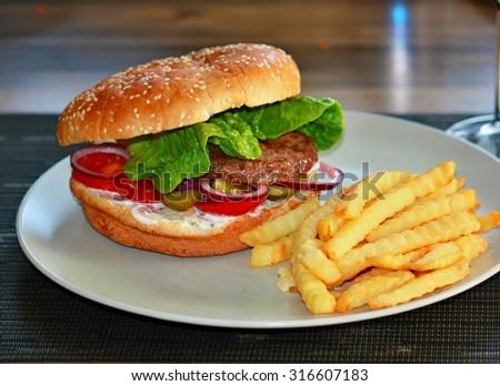 Homemade hamburger with potato chips - stock photo
