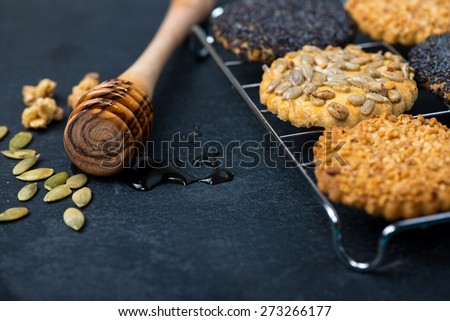 homemade healthy cookie with seeds and honey on cooling tray - stock photo