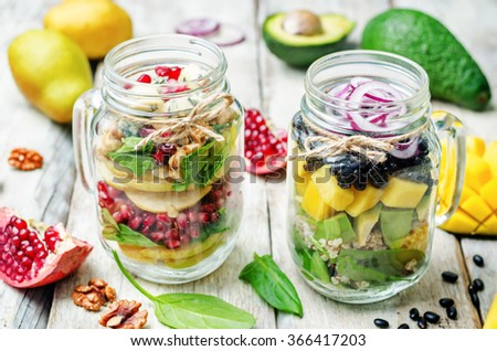 homemade healthy salads with vegetables, fruits, beans and quinoa in jar. toning. selective Focus - stock photo