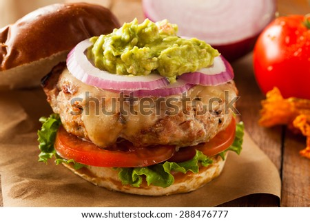 Homemade Healthy Turkey Burgers with Lettuce and Tomato - stock photo