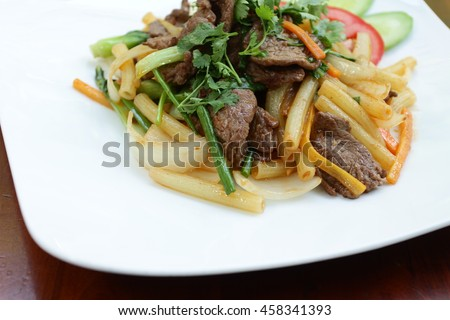 Homemade Hearty Beef Stroganoff with tomatoes and Noodles - stock photo