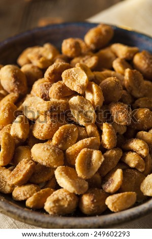 Homemade Honey Roasted Peanuts in a Bowl - stock photo