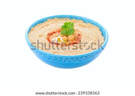 Homemade hummus on white background - stock photo