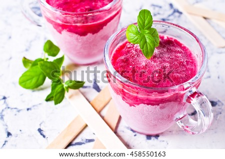 Homemade ice cream from berries on a light background. Selective focus. - stock photo