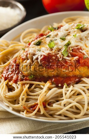 Homemade Italian Chicken Parmesan with Cheese and Sauce - stock photo