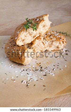 Homemade italian focaccia bread with thyme and sea salt - stock photo