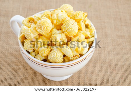 Homemade Kettle Corn Popcorn in a bowl on sack background. - stock photo