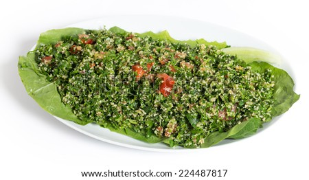 Homemade Lebanese-style tabouii, made with raw parsley, mint, cucumber, tomato, burghal aka bulgar wheat, lemon juice, olive oil, salt and spices. - stock photo