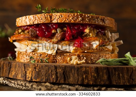 Homemade Leftover Thanksgiving Sandwich with Turkey Cranberries and Stuffing - stock photo