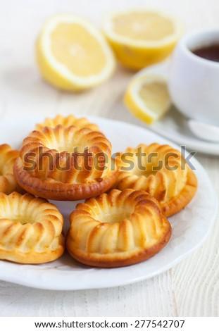 Homemade lemon cakes on white wooden table. Sselective focus. - stock photo