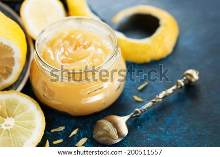 Homemade lemon curd in glass jar - stock photo