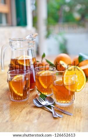 Homemade lemonade / ice tea with fresh oranges - stock photo