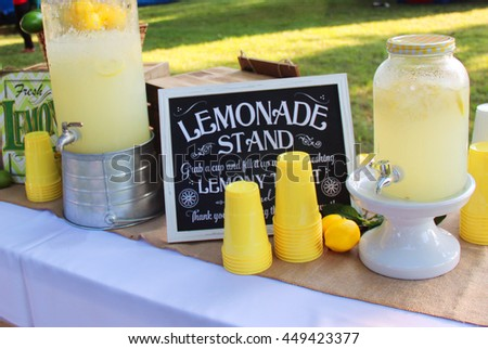 Homemade lemonade in a jar with cups - stock photo