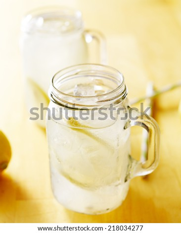 homemade lemonade in mason jar with straws to the side - stock photo