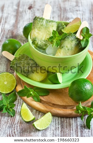 Homemade lime and mint frozen popsicles. Selective focus. - stock photo